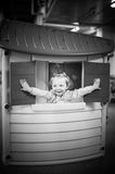 Cute baby girl head out of plastic window Royalty Free Stock Images