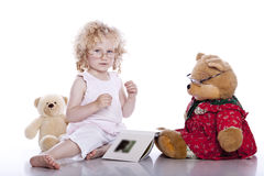 Cute baby girl with her teddy bear Royalty Free Stock Image