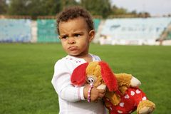 Cute baby girl with her toy Stock Photo