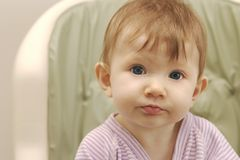 Cute Baby girl in highchair Stock Photography