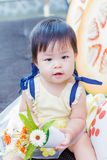 Cute baby girl hold flower at studio photo stock photography
