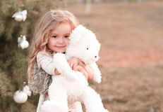 Free Cute Baby Girl Holding Bear Toy Stock Image - 77426861