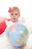 Cute baby girl holding world globe Royalty Free Stock Photos