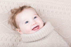 Cute baby girl in knitted sweater on knitted blanket Royalty Free Stock Images
