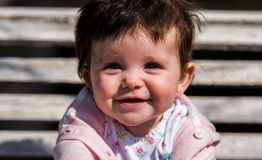 Cute baby girl laughing wearing jeans Stock Photos