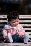 Cute baby girl laughing wearing jeans Royalty Free Stock Photos