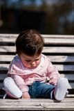 Cute baby girl laughing wearing jeans Stock Photography
