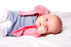 Cute baby girl laying in crib Stock Images