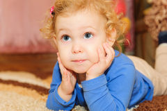 Cute baby girl leaning on her hands Royalty Free Stock Image