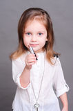 Cute baby girl with lipstick Stock Photo