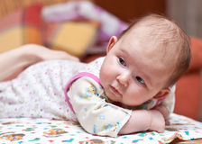 Cute baby-girl looking at mom Stock Photo