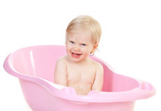 Cute baby girl loves bathing in the bath Royalty Free Stock Photo