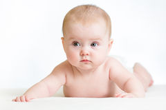 Cute baby girl lying on belly Stock Photos