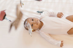 Cute Baby Girl Lying in the Crib Stock Images