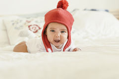 Cute Baby Girl Lying in the Crib. Royalty Free Stock Photography
