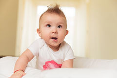 Cute baby girl is making a funny face Royalty Free Stock Images