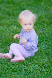 Cute baby girl on meadow Royalty Free Stock Photos