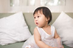 Cute baby girl with milk mustache at home royalty free stock photo