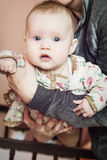 Cute baby girl in mother's arms Royalty Free Stock Image