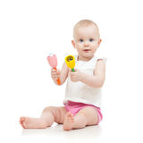 Cute baby girl with musical toys Stock Photos