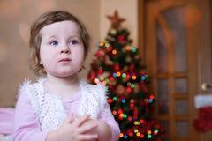 Cute baby girl over Christmas tree Royalty Free Stock Photos