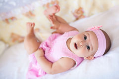 Cute baby girl in a pink dress Stock Photo