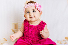 Cute baby girl in pink dress. Cute baby girl in pink floral dress Royalty Free Stock Photo