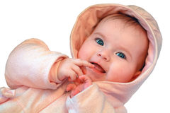 Cute baby girl in pink playing with hands Stock Image