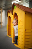 Cute baby girl in a plastic house Royalty Free Stock Image