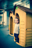Cute baby girl in a plastic house Royalty Free Stock Images