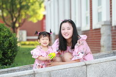 Cute baby girl play balls with mother Stock Images