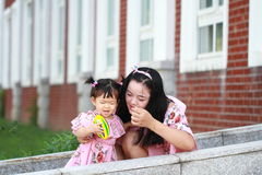 Cute baby girl play balls with mother Royalty Free Stock Photo