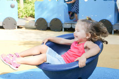 Cute baby girl on playground Stock Image