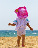 Cute baby girl playing on the beach Stock Photo
