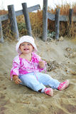 Cute baby girl playing on the beach Royalty Free Stock Image