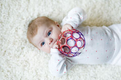 Cute baby girl playing with colorful rattle ball toy Stock Photography