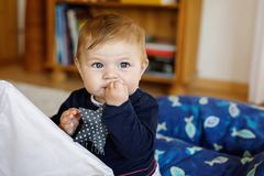 Cute baby girl playing with colorful soft toy. Cute happy smiling baby playing with soft toy. Portrait of adorable little girl looking at the camera and smiling royalty free stock images