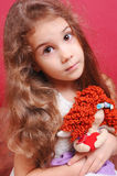 Cute baby girl playing with handmade doll Stock Images