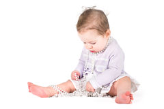 Cute baby girl playing with pearls Royalty Free Stock Photos