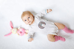 Cute baby girl playing with plush animal toy Royalty Free Stock Photos