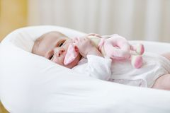 Cute baby girl playing with plush animal toy Stock Image