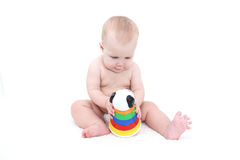 Cute baby girl plays toy Royalty Free Stock Photo