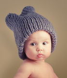 Cute baby girl. Portrait of cute happy 4 month old baby girl with funny hat Royalty Free Stock Photography