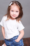 Cute baby girl posing on gary Royalty Free Stock Images