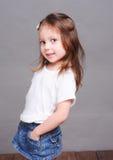 Cute baby girl posing on gary Stock Photography