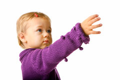 Cute Baby Girl Reaching For Something. Portrait of baby girl looking up to reach something Stock Photography