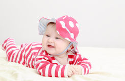 Cute baby girl in red hat Stock Photo