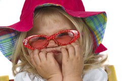 Cute baby girl in a red hat and sunglasses. stock image