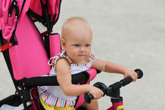 Cute baby girl riding her first bicycle Royalty Free Stock Photos