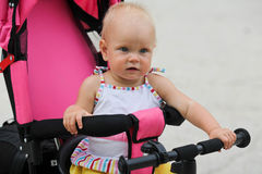 Cute baby girl riding her first bicycle Royalty Free Stock Photo